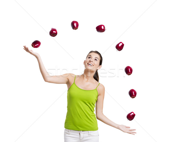 3224079_stock-photo-woman-throwing-apples